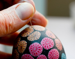 Before baking the egg, I use a very fine sewing or beading needle to poke a tiny hole through the clay and the hole underneath to allow for air expansion inside the egg.