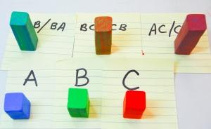 """J'utilise la même procédure pour faire mon Colombie-Britannique et les places AC, et faire des blocs carrés avec des couleurs solides. Ce sont aussi 1/2 """", mais la moitié de la longueur des équerres combinées de couleur (1"""" au lieu de 2 """"de long)"""
