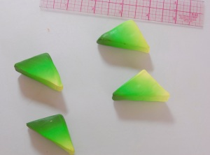 10.	The 2 triangles are cut in half to make 4 triangles.